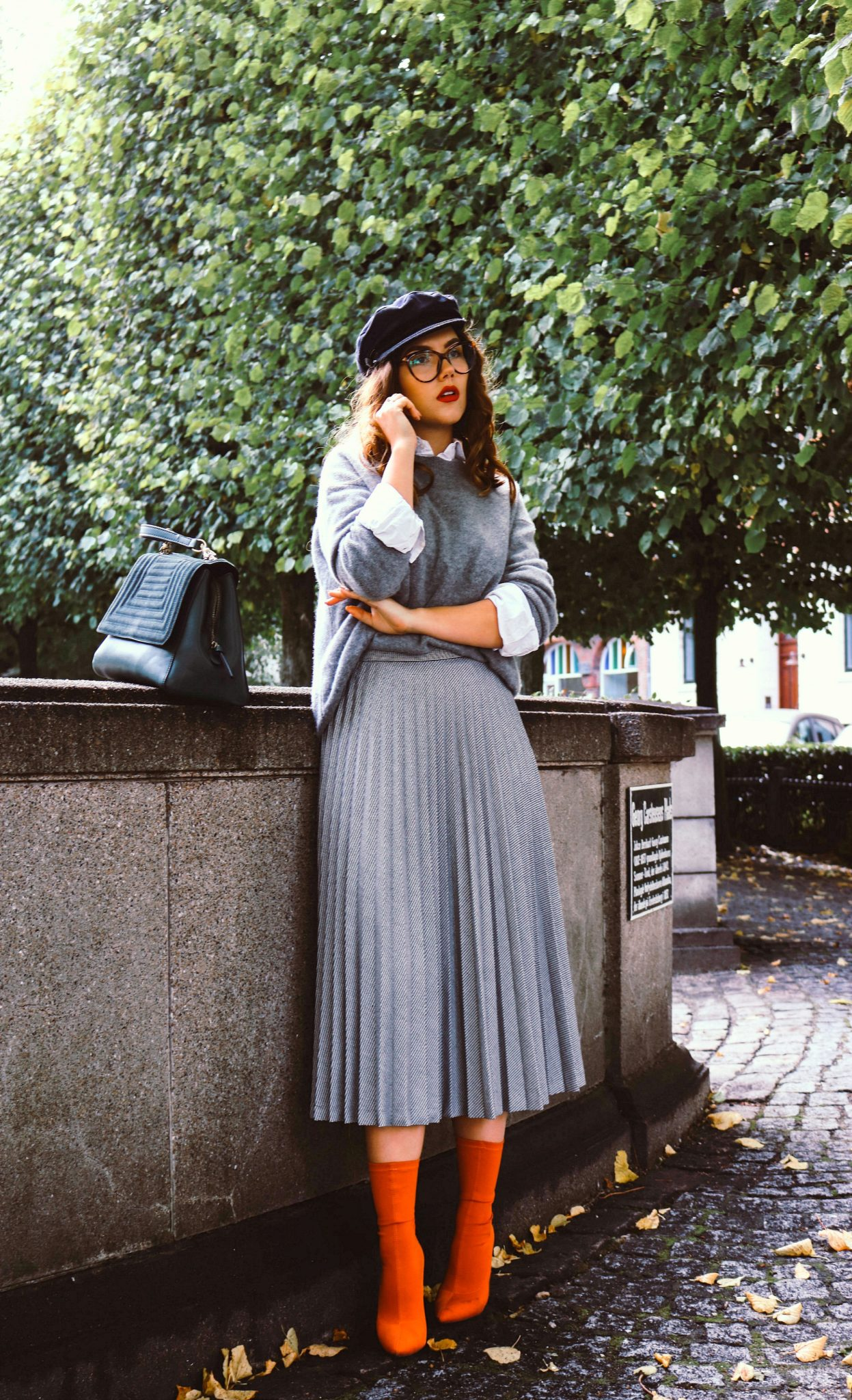 pleated midi skirt and sock boots