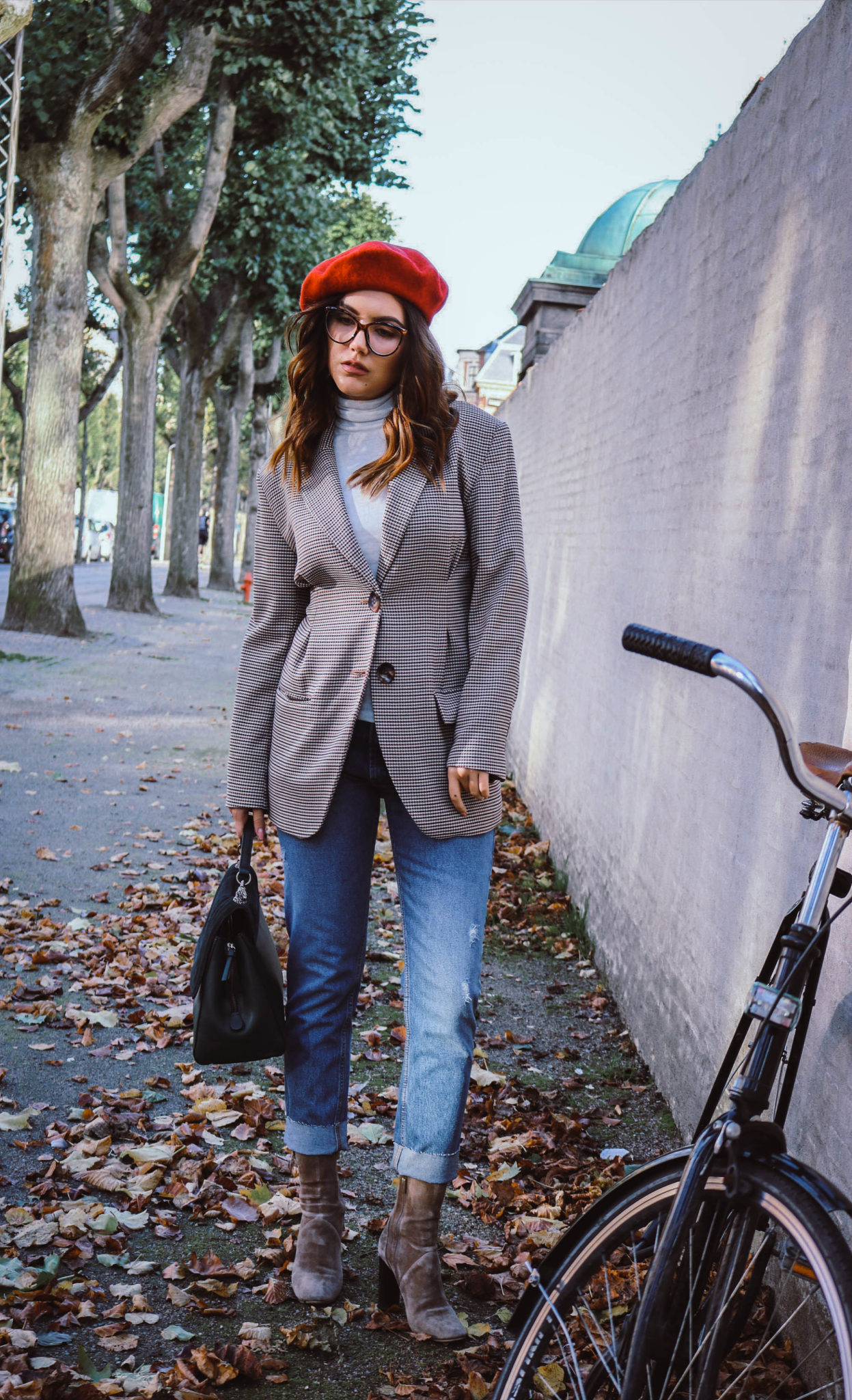 ee5b5367 I chose to wear this red beret with a checked blazer, which has been in the  light spot at fashion weeks for some time now too and jeans.