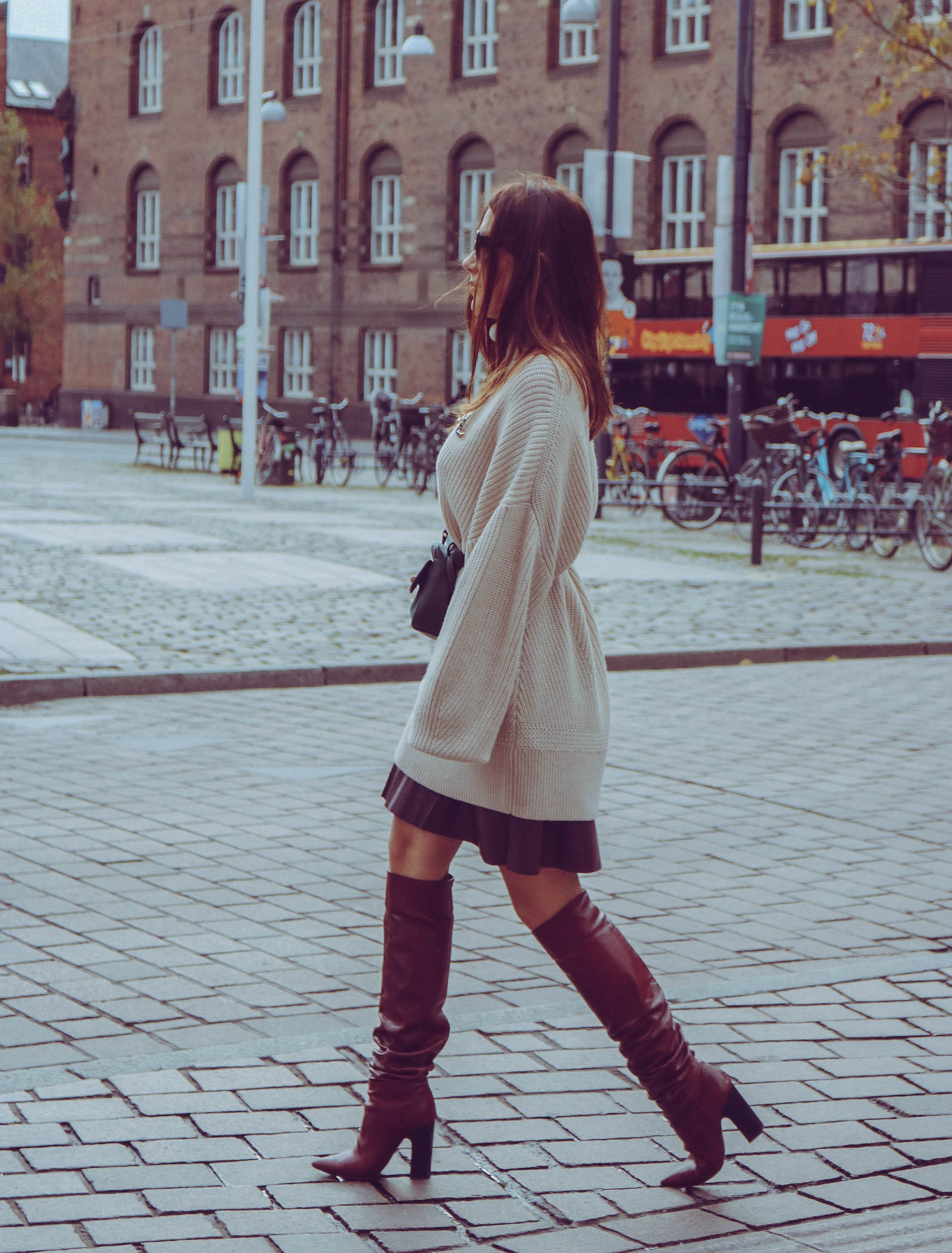 oversized knitwear and high boots